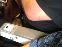 airplane armrest rules, armrest arguements